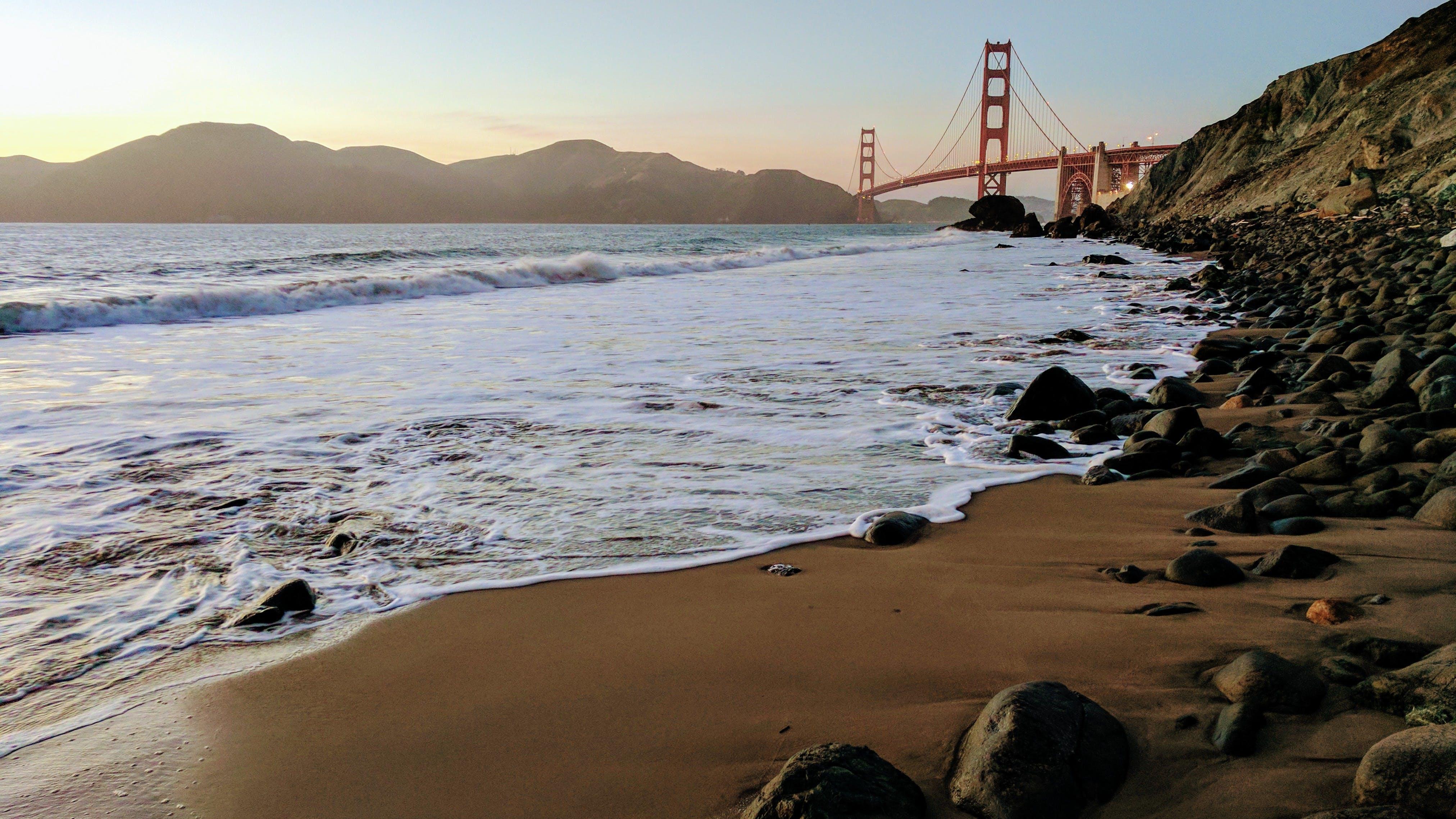 Red Steel Bridge over Calm Sea