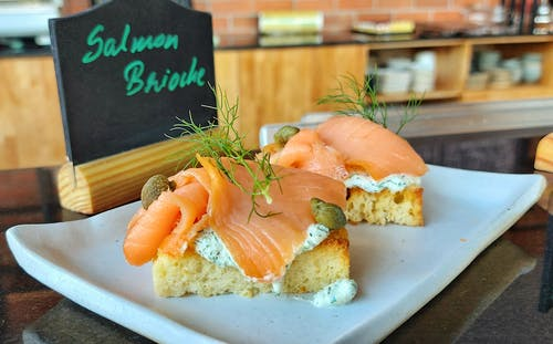 Served snack with salmon in cafe