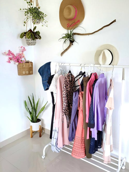 Pink and Black Shirts Hanged on White Wall