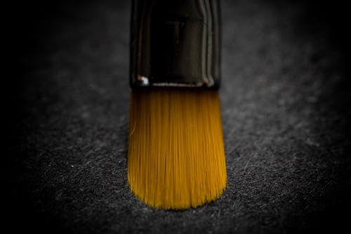 Brown and Black Brush on Black Surface