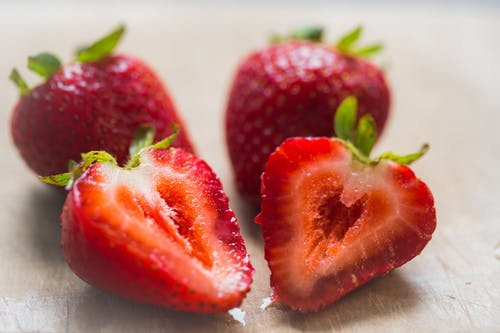 Red Strawberries on White Surface