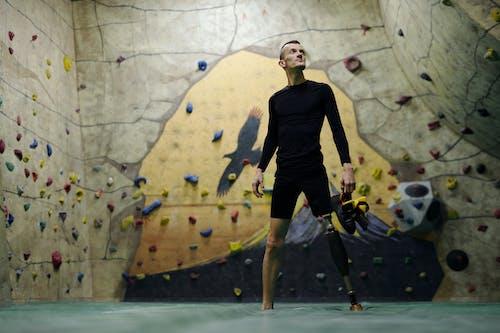 Man Standing Beside Climbing Wall
