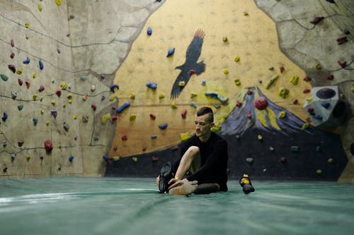 Man Getting Ready For Wall Climbing