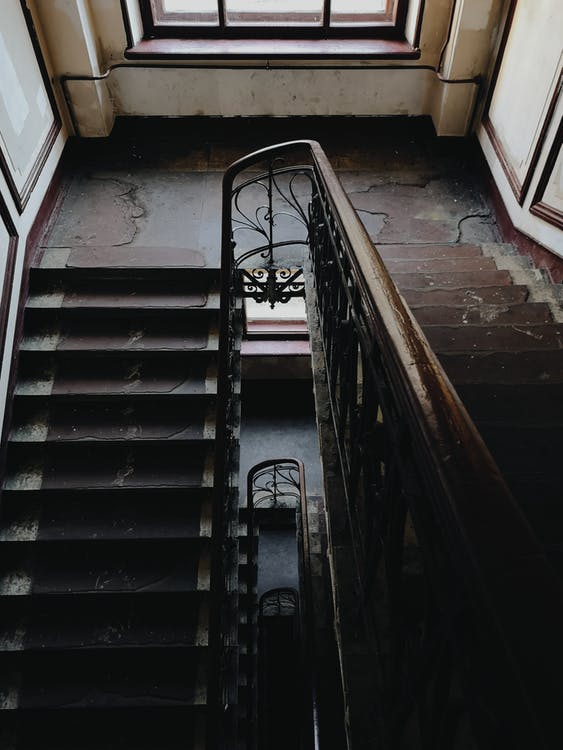 Black Metal Railings on Brown Concrete Staircase