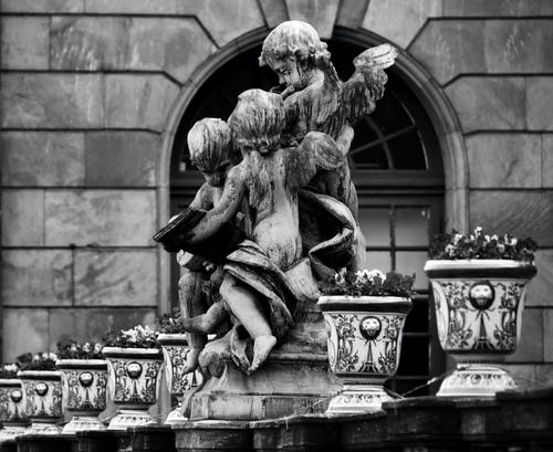 Grayscale Photo of Angel Statues