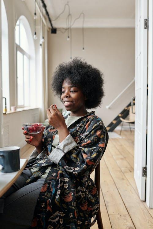 Woman Eating Berries