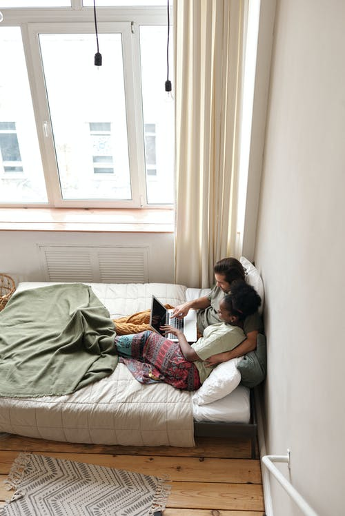 Couple in Bed With a Laptop