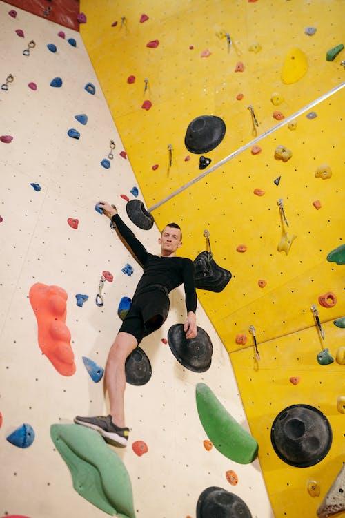 Man in Black Shorts Doing Wall Climbing