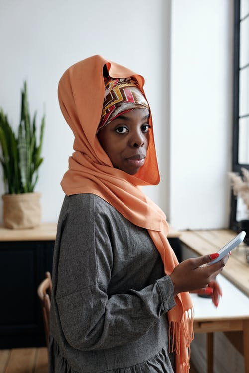 Portrait of Muslim Woman Using Smartphone