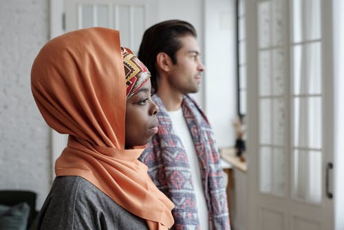 Muslim Couple Looking Out the Window