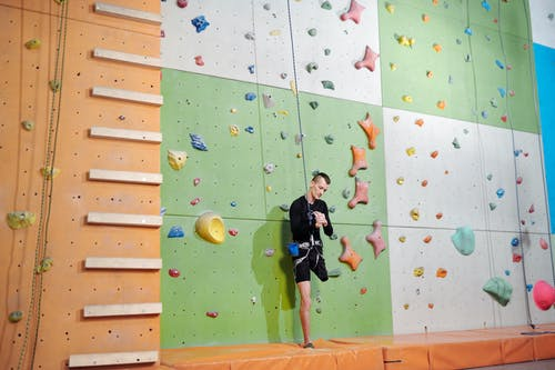 Man in Black Shorts Doing Wall Climbing