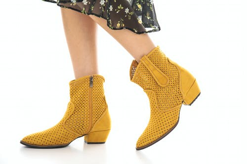 Woman in Yellow Boots
