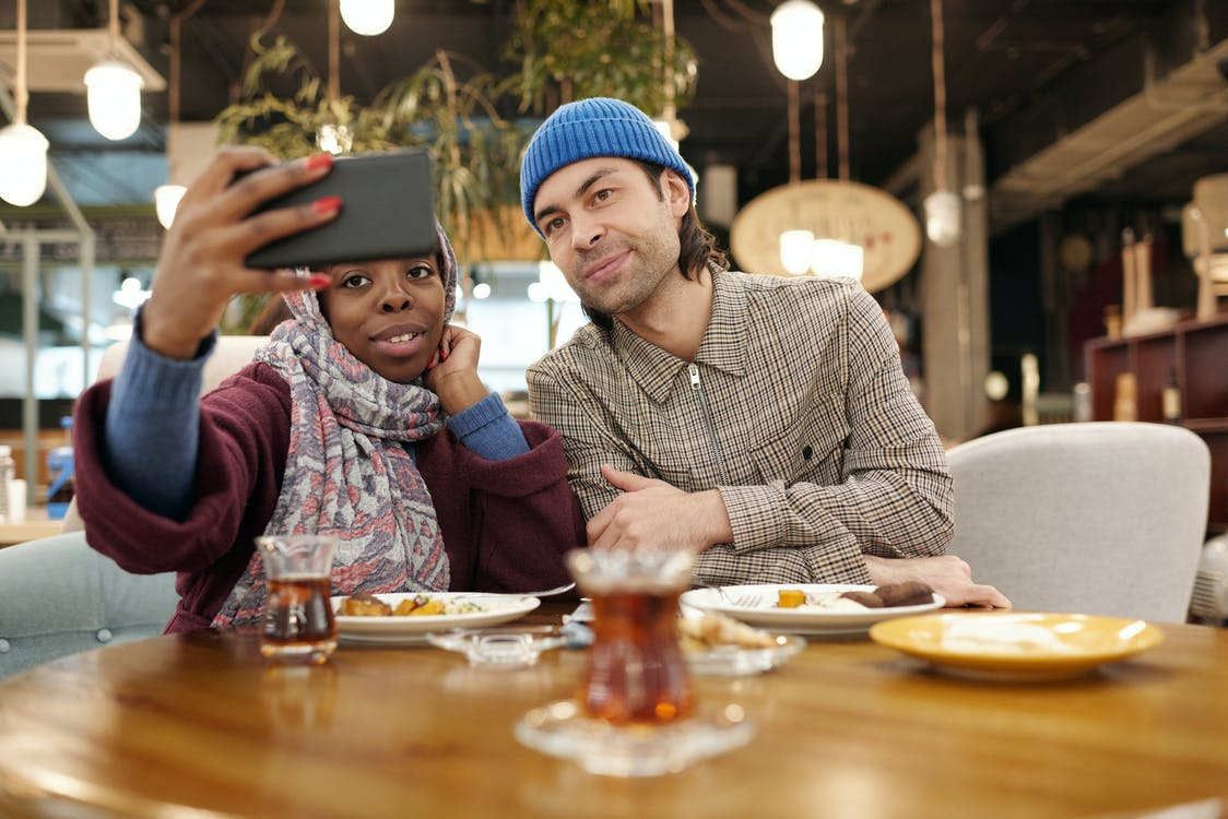 Couple Taking Selfie in Restaurant