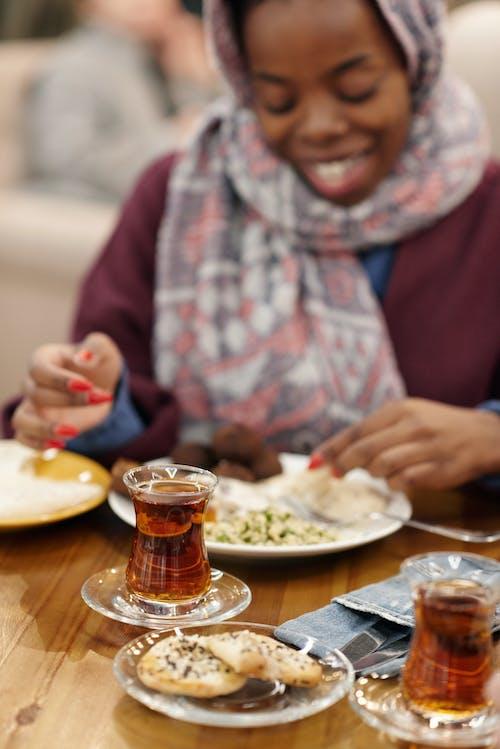 Muslim Woman in Restaurant