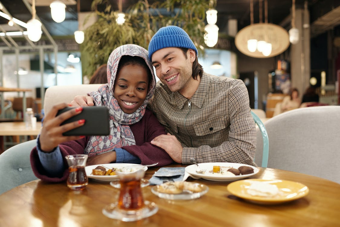 Couple Taking Selfie While Eating