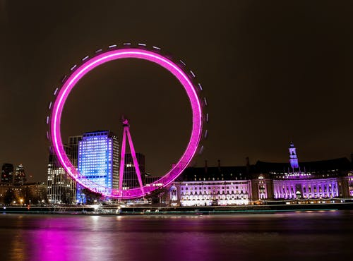 Purple and White Ferris Wheel during Night Time