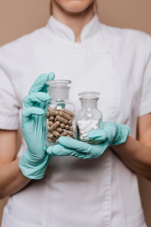 Foto stok gratis antibiotik, antibiotika, apoteker, botol