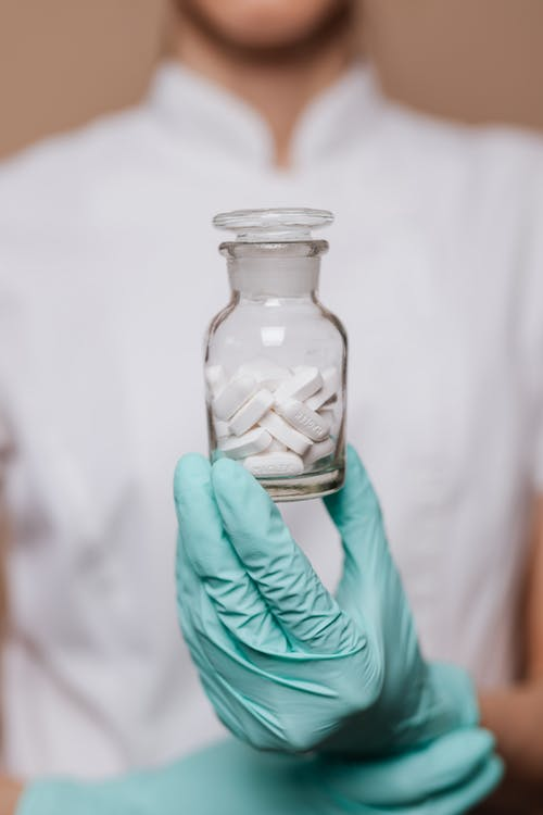 White Tablets on Clear Bottle
