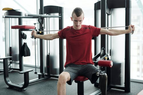 Photo Of Man In Red Shirt Exercising