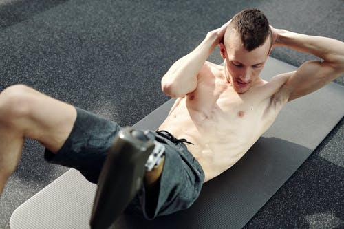 Man in Shorts Doing Abdominal Exercise