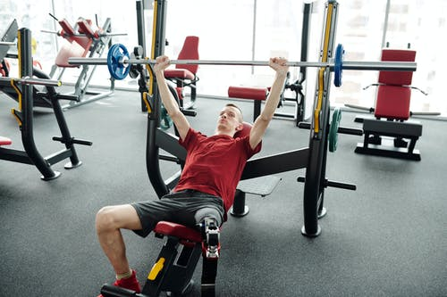 Photo Of Man Lifting Weights