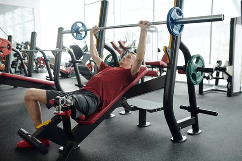 Photo Of Man Lifting A Barbell