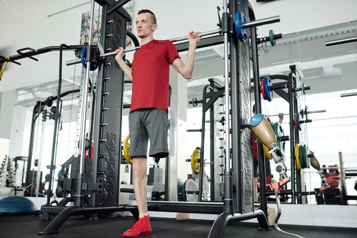 Photo Of Man In Red Shirt Lifting Barbell