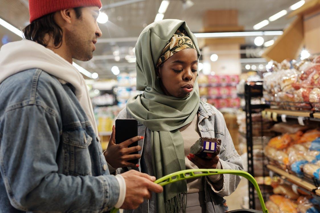 Muslim Couple Buying Groceries