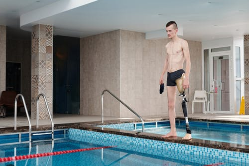 Man in Black Shorts Standing on Swimming Pool