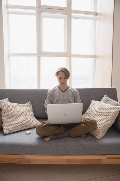 Man Sitting on the Couch with His Laptop