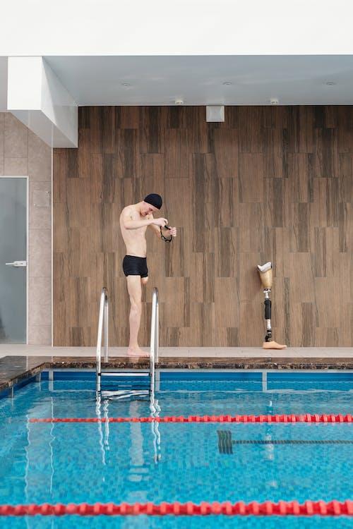Photo Of Man Beside Swimming Pool