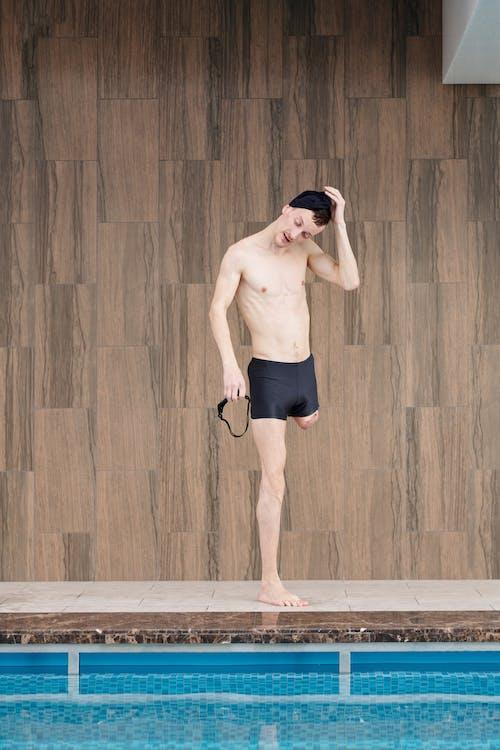 Photo Of Man Standing Beside Pool