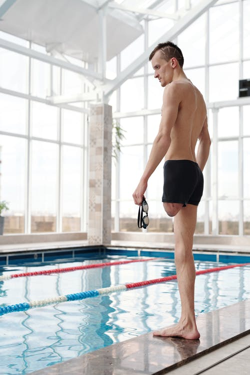 Photo Of Man Standing On Poolside