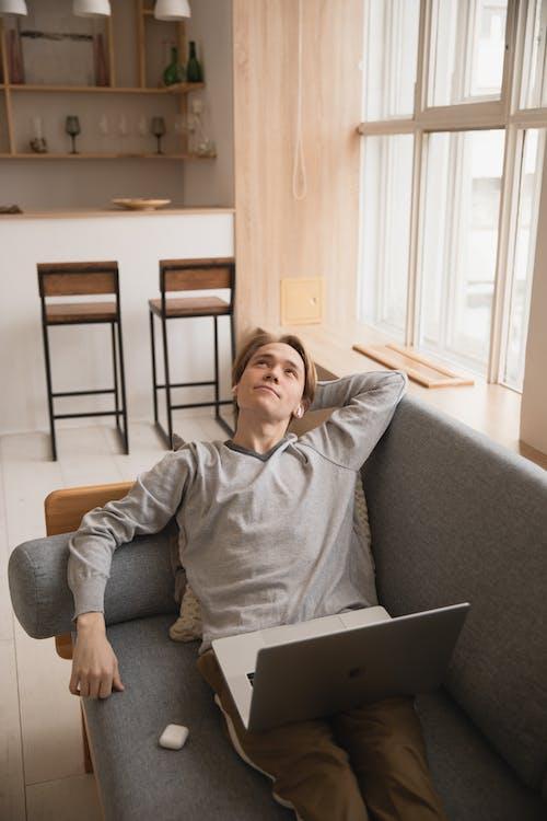 Photo Of Man Laying On Sofa