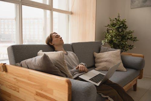 Photo Of Man Sleeping On Sofa