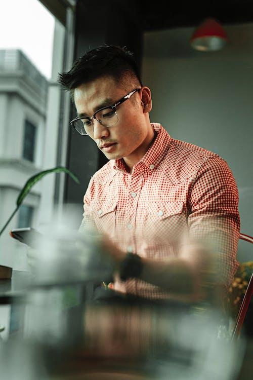 Photo Of Man Using Black Eyeglasses