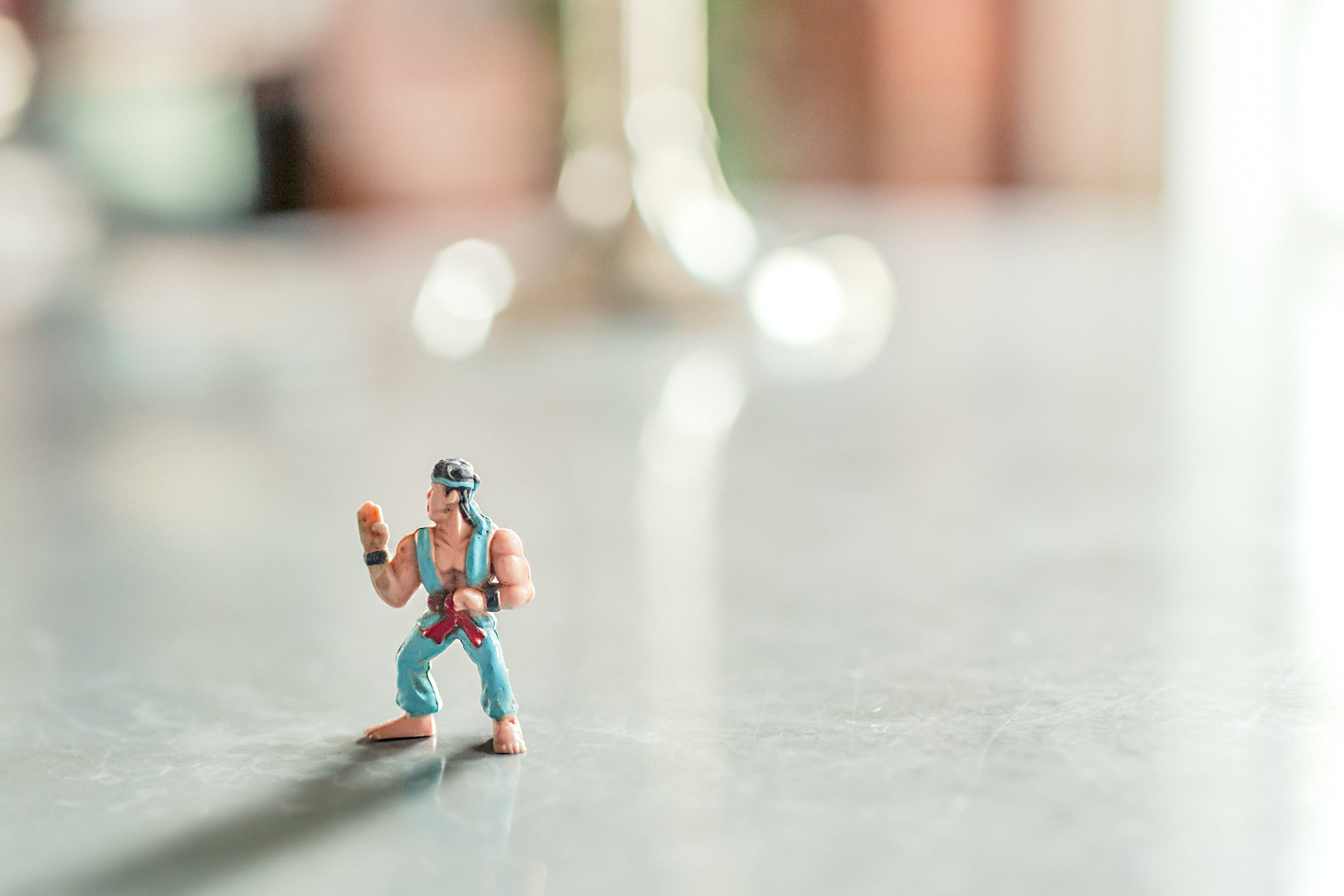 Selective Focus Photography of Male Character Figurine