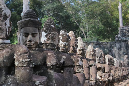 Aged stone statues of Buddha in Angkor Thom
