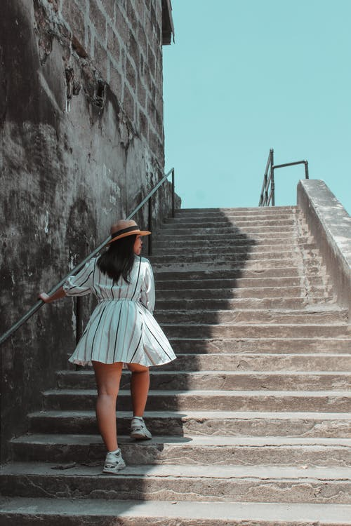 Photo Of Woman Using The Stairs