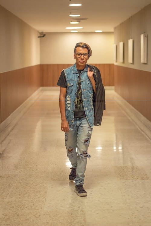 Photo Of Man Walking On Hallway