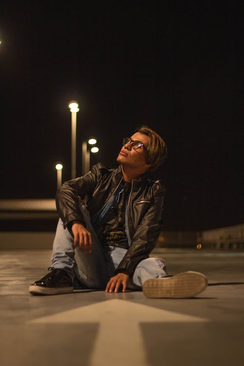 Photo Of Man Sitting On Ground