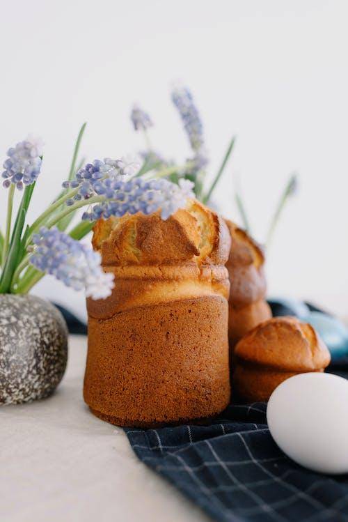 Photo Of Bread Beside Flowers