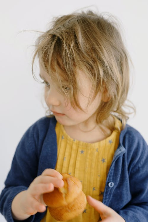 Photo Of Child Holding Bread