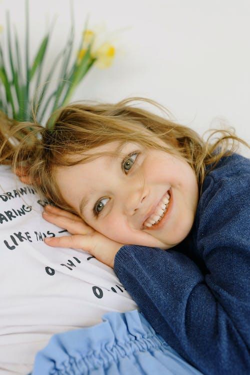 Photo Of Child Wearing Blue Sweater
