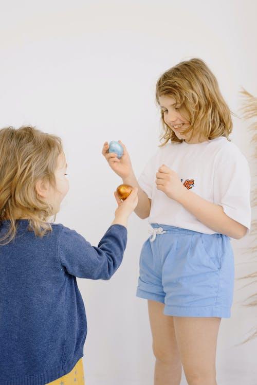 Photo Of Children Holding Easter Eggs