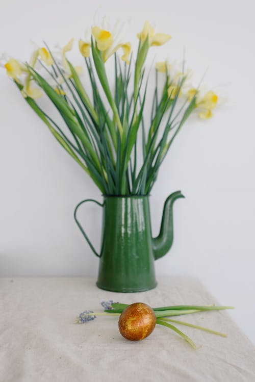 Easter Egg and Flowers on a Table