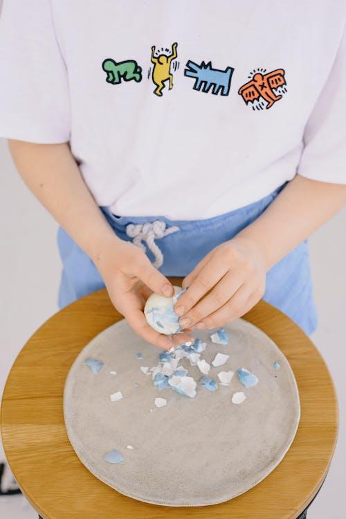 Child Peeling an Easter Egg
