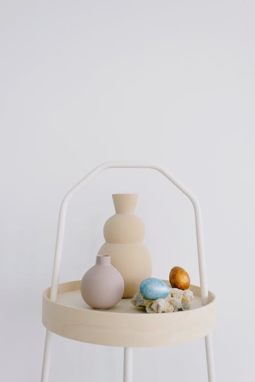 Vases and Easter Eggs on a Small Table