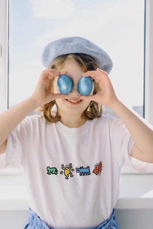 Little Girl Holding Blue Eggs