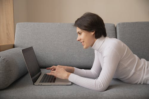 Photo Of Person Using Laptop